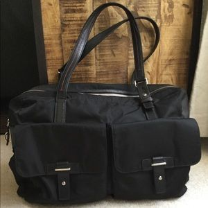 Tumi nylon bag with leather straps and trim